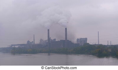Industrial, Metallurgical Plant in the City Working at Full Power. Smoke from Pipes.