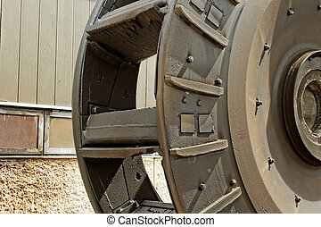 industrial coal mill wheel details (close up) sephia