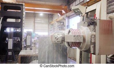 Industrial milling machine robot working on workpiece
