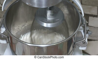 Industrial mixer whipping marshmallow mixture at...