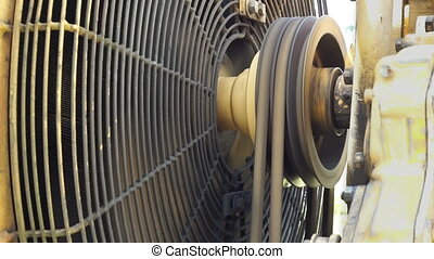 Industrial Motor Fanbelt Turning - Close up shot of the...