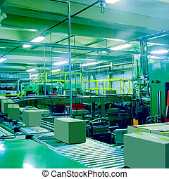 industrial packaging automatic machine with cardboard boxes on it