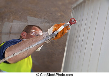 Industrial Painter - Industrial painter painting metal...