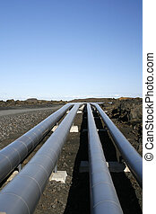 industrial pipelines in vulcanic landscape - pipelines in a...