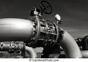 industrial pipelines on pipe-bridge against blue sky b&w