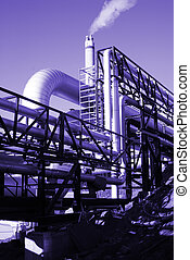 industrial pipelines on pipe-bridge against blue sky in blue tone