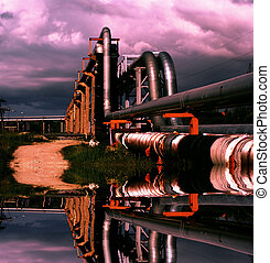 industrial pipelines on pipe-bridge against blue sky with...