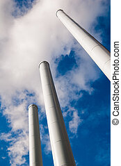 Industrial pipes against the sky