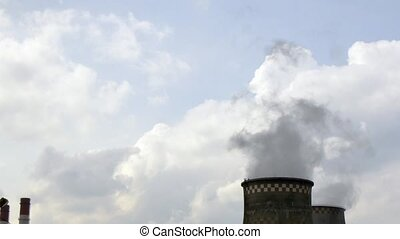 Industrial pipes of plant chimney smoke.