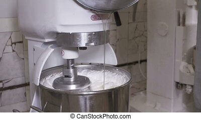 Industrial planetary mixer whipping marshmallow mixture into...