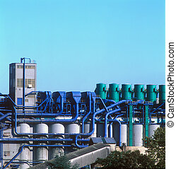 Industrial plant with color-coded process piping and tanks