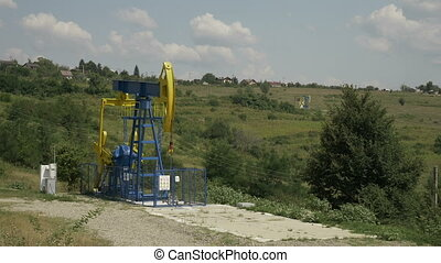 Industrial platform with oil pumping units with rural scene...