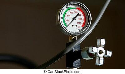 industrial pressure barometer loop at work close-up at green line