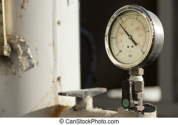 Industrial Pressure Gauge - Industrial pressure gauge on a...