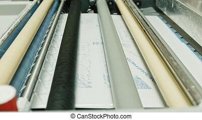 industrial printing of posters - print production, the developer in the photo process