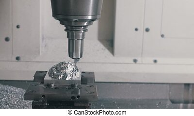 Industrial production. CNC machine engrave logo - Industrial...