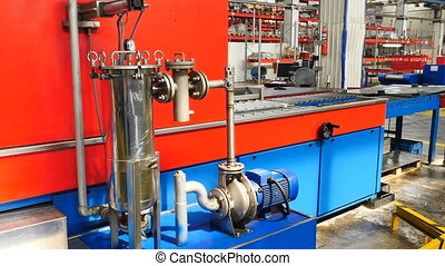Industrial production line in modern factory. Modern Automated Line at Plant of bearing assembling, Technology, Steel Machine, Pipes, Pressure gauge. Factory equipment. 4 k