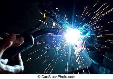 Industrial professional worker welding metal