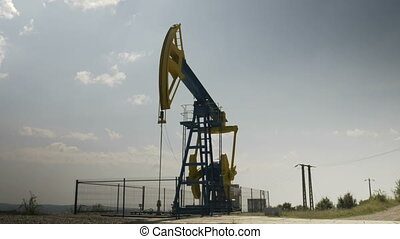 Industrial pumpjack unit extracting and pumping oil
