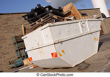 industrial recycle skip with trash waste outside, ad on ...