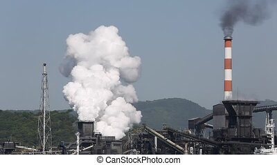 Industrial refinery plant with smoke, air pollution