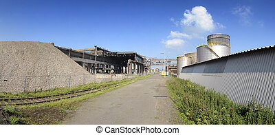 Industrial ruin and new factory - An industrial ruin and a...