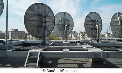 industrial satellite dishes on the roof of a building