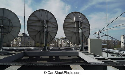 industrial satellite dishes on the roof