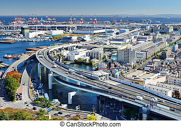 Metropolitan Expressway passes ports in the distance in Yokohama, Japan, the second largest city in the country.