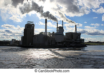 Industrial silhouette - Pulp and paper mill beside the ...