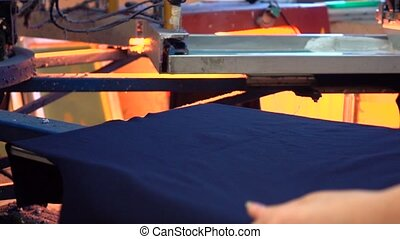 Industrial silk screen printing machine in action