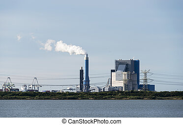 industrial skyline with cranes and power plant in Holland europoort