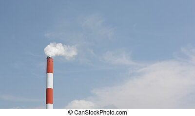 Industrial smoke stack - Smoke stack with smoke on blue sky...