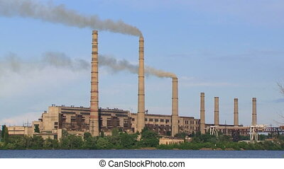 Industrial Stacks Of Coal Power Plant Injecting Smoke