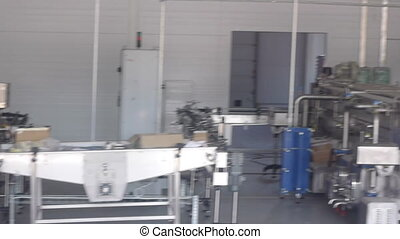 Industrial stainless steel equipment inside food plant