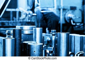 Industrial steel cylinders, pistons in workshop. Industry theme.