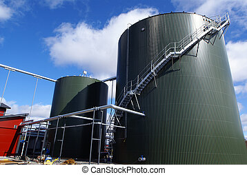 industrial tanks with pipelines against blue sky