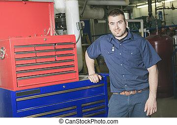 industrial technician inside a industrial place