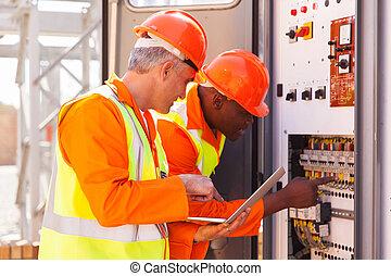 industrial technicians checking transformer