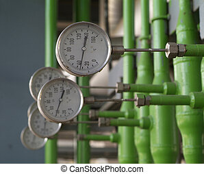 Industrial temperature meters for liquids. Shallow depth of ...