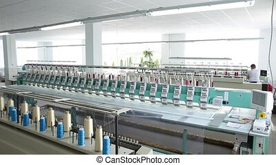 industrial textile machines in a row.