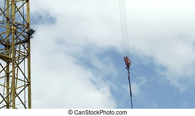 Industrial Tower Crane Block and Chain Hook Swinging - The...