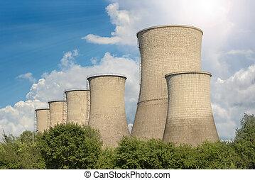 Industrial towers against summer sky