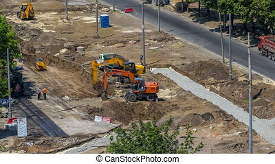 Industrial truck loader excavator moving earth and loading...