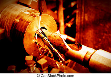 Industrial turning, threading machine at work