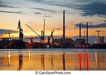 Industrial view at sunset in shipyard of Gdansk, Poland.