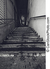 Industrial warehouse concrete staircase, black and white