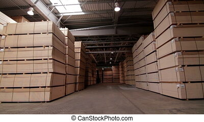 Industrial warehouse with chipboards