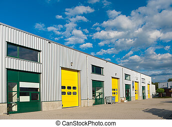 warehouse - industrial warehouse with green and yellow ...