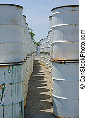 Industrial Waste - Rows of industrial waste barrels on a...